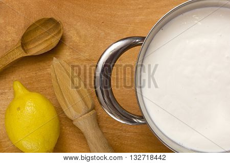 Kit for the preparation of mascarpone cheese at home on a wooden background