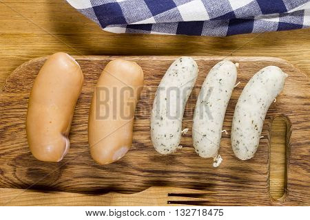 Traditional German sausages on a wooden cutting board