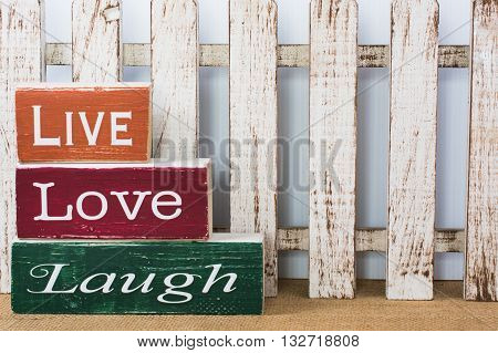 White picket fence with Live Love Laugh in painted wood blocks