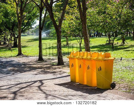 Yellow recycle bins in public park in Bangkok