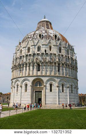 Pisa Italy - June 29 2015: Tourists near the Baptisery of St. John (Battistero di San Giovanni). Province Pisa Tuscany region of Italy