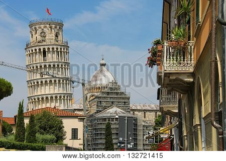 Pisa Italy - June 29 2015: View to bell tower of the Cathedral (Leaning Tower of Pisa). Province Pisa Tuscany region of Italy