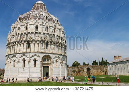 Pisa Italy - June 29 2015: Tourists near the Baptistery of St. John (Battistero di San Giovanni). Province Pisa Tuscany region of Italy