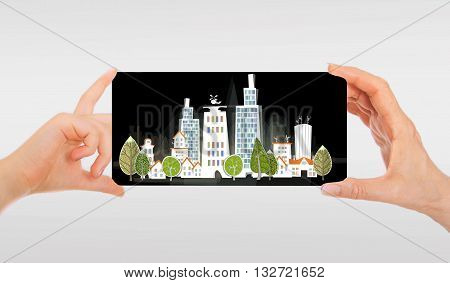 Hand holding white paper City background, with space for text