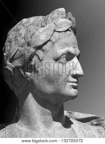 Gaius Julius Caesar sculpture on a gray background.  Marble bust of  Roman general in the Summer Garden of Saint Petersburg.
