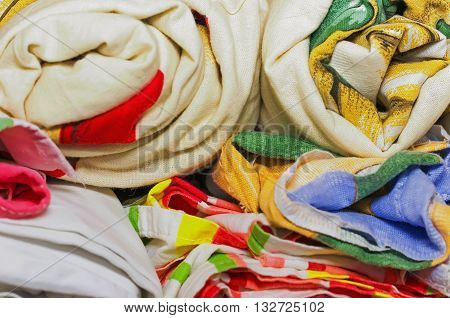 linens rolled rolls piled stacks in a closet cabinet furniture for home interior home textile wash and proutyuzhenny colorful soft focus