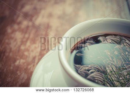 Grass Flower Reflection On Coffee