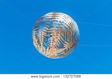 Wellington New Zealand - November 18 2014: Silver fern-patterned filagree suspended globe Civic Centre Wellington New Zealand.