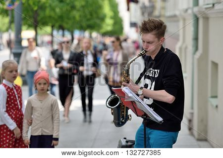 VILNIUS LITHUANIA - MAY 21: Unidentified musicians play Saxophone in Street music day on May 21 2016 in Vilnius. Its a most popular event on May in Vilnius Lithuania