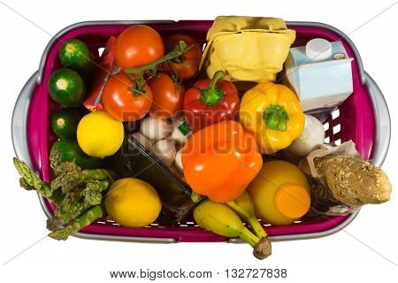 Shopping basket full with food products isolated on white background and seeing from the top view