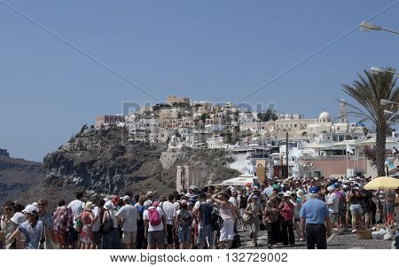 THIRA SANTORINI GREECE - AUGUST 8 2013: A lot of tourists on the streets of Thira. Santorini is always a lot of tourists