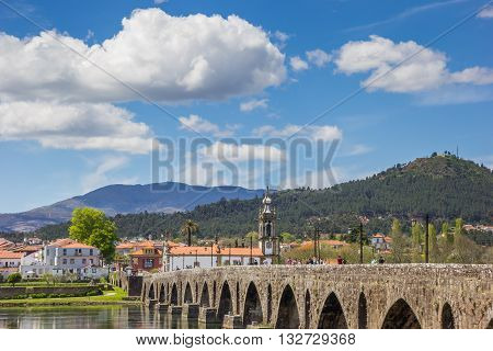 PONTE DE LIMA, PORTUGAL - APRIL 24, 2016: Church and roman bridge in Ponte de Lima, Portugal