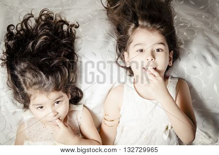 Little sister on Silky bed inside bedroom