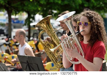 VILNIUS LITHUANIA - MAY 21: Unidentified musicians play Trumpet in Street music day on May 21 2016 in Vilnius. Its a most popular event on May in Vilnius Lithuania