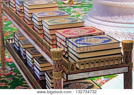 Quran in the mosque lies on the shelves stacks of the book of the Muslim religion Islamic books for sale Arabic Religion