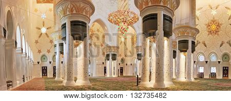 Sheikh Zayed Mosque in Abu Dhabi in the interior chandelier of Swarovski stones a large rug United Arab Emirates April 14 2014 soft focus