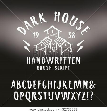 Vector handwritten brush font in horror style. White print on blurred background