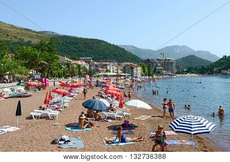 PETROVAC MONTENEGRO - SEPTEMBER 19 2015: Unidentified people are relaxing on the beach in the popular resort town of Petrovac Montenegro