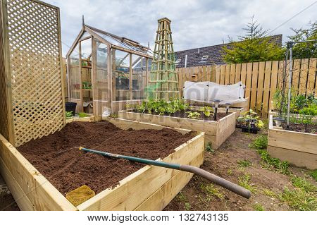 Wooden climbing trellis in vegetable garden or allotment