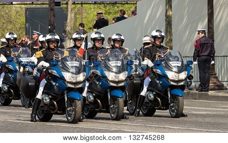 Paris France-May 08; 2016 : The motocycle escort of French President on Champs Elysees avenue in Paris during commemoration of Victory day in World War II.