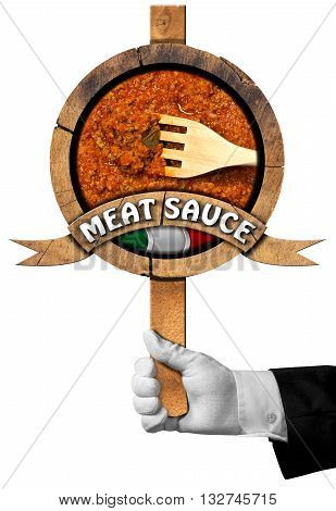 Hand of chef holding a wooden sign with italian meat sauce (Bolognese sauce) with text Meat Sauce Italian flag and wooden fork