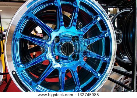 close up of new automobile alloy wheels.