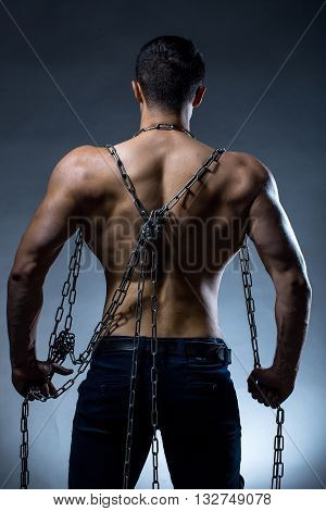 Muscular Guy With Chain On Back