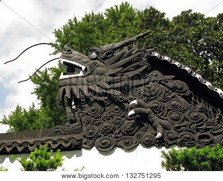 The dragon on the garden wall of the Mandarin Yu. It is a classical Chinese garden located in the northeast of the old city of Shanghai China.