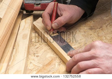 carpenter working hammermeter and screw-driver on construction background.