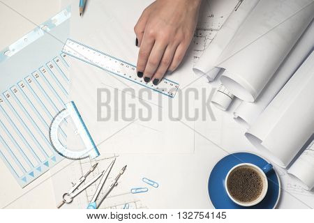 Architect working on blueprint. Architects workplace - architectural project blueprints ruler and divider compass. Construction concept. Engineering tools.
