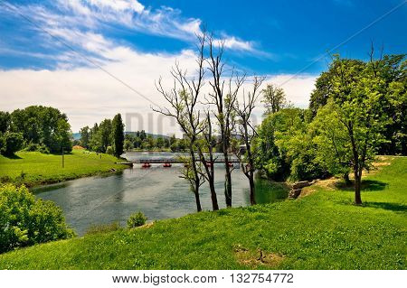 Korana river landscape in Karlovac green landscape and bridge