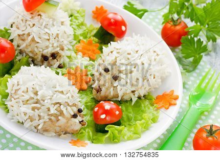 Steamed meat and rice hedgehogs with vegetables fun idea for children dinner selective focus