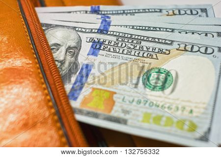Dollar Notes In A Wallet, Hundred-dollar Bills Are In A Bag,