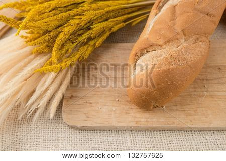 French Bread Baguettes On Bread Board On Burlap Texture