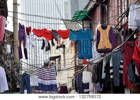 SHANGHAI CHINA - MARCH 19: Clothes line in a street on March 19 2016 in Shanghai China. Shanghai is the largest Chinese city by population.