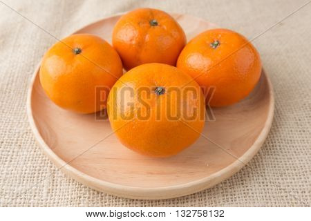 Group Of Mandarin Oranges, Tangerines Fruit On Burlap Sack Background
