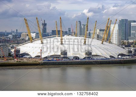 The o2 arena, London, September 2015. Against the backdrop of Canary Wharf, the o2 arena sits on the banks of the River Thames.