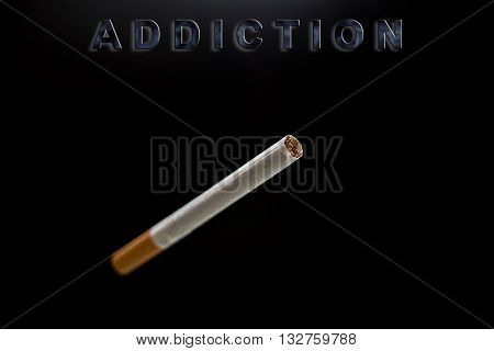 cigarette and text addiction on black background