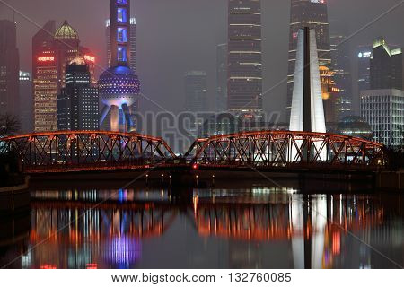 SHANGHAI CHINA - MARCH 19: Waibaidu Bridge on March 19 2016 in Shanghai China. The Waibaidu Bridge called the Garden Bridge in English is the first all-steel bridge in China.