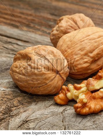 dried walnuts on wooden background in studio