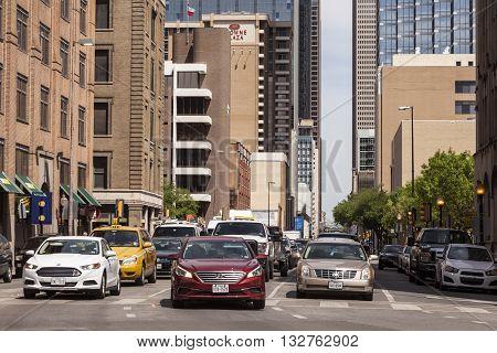DALLAS USA - APR 7: Cars on the street downtown in Dallas. April 7 2016 in Dallas Texas United States