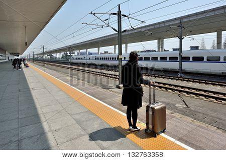 TONGXIANG, CHINA - MARCH 25, 2016: Passengers waiting at Tongxiang Railway Station on March 25, 2016 in Tongxiang, China. Tongxiang City is a county-level city in northern Zhejiang Province, China.