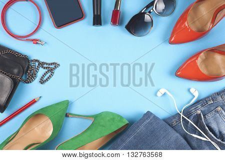 Women Clothing Set And Accessories On A Rustic Wooden Background.top View,  Different Shoes On  Ligh