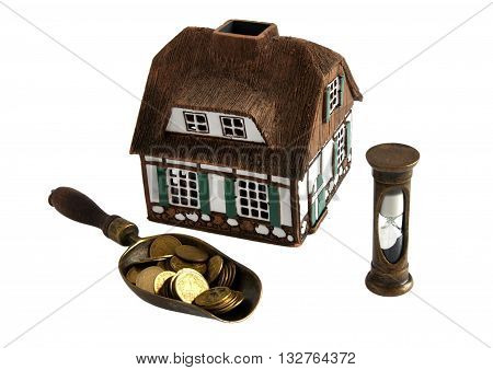 House model coins and hourglass symbolize the rapid favorable credit mortgages concept - isolated on white background