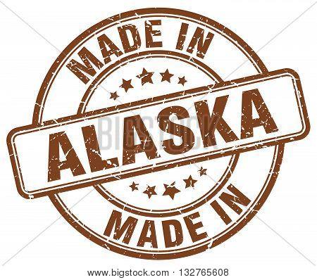 made in Alaska brown round vintage stamp.