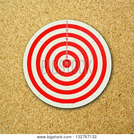 Dartboard isolated on a brown color background