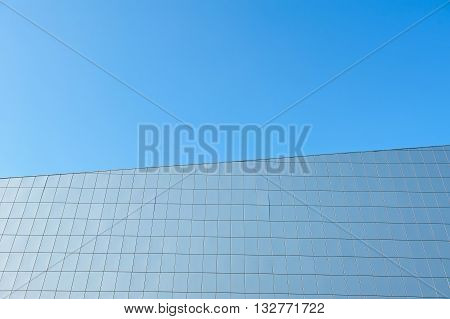 Facade of a modern building against the blue cloudless sky