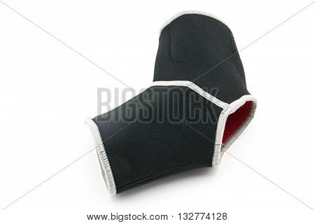close up of black ankle support on white background