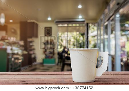 Coffee paper cup in coffee shop blur background