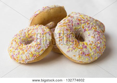 Doughnut for tea. Donuts stacked slide. Tasty food cakes. Delicious classic cakes: fried doughnuts glazed with caramel. Nutritious dish that promotes obesity.